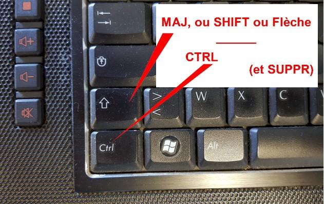 La touche maj est parfois une flèche ou bien notée SHIFT